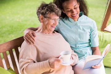 Caregiver and senior in garden
