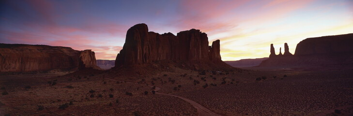 View towards The Three Sisters at dusk, Monument Valley Tribal Park, Arizona, United States of America, North America