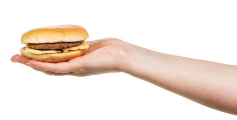Tasty burger sandwich in hand isolated on white