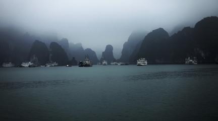 Boats at Halong bay against sky, Vietnam