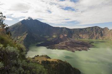 Scenic view of Mount Rinjani against cloudy sky at Lombok, Indonesia