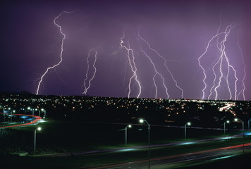 Fork lightning at night over a city