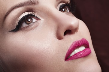 girl with bright purple lipstick