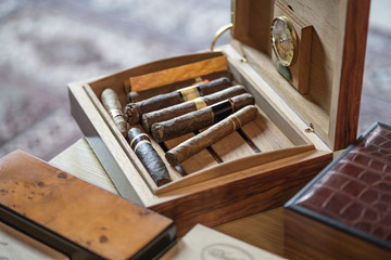 High angle view of cigars in wooden box on table