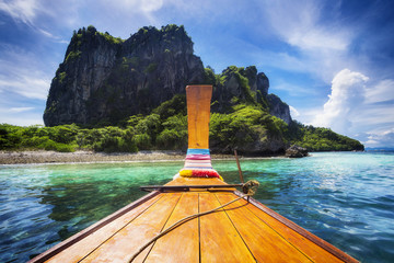 Traditional longtail boat on the way to famous Maya Bay beach in Koh Phi Phi Island, Thailand.