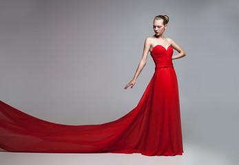 Model with flying skirt of red dress