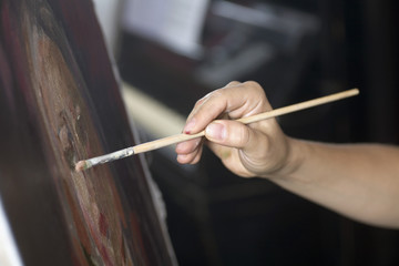 Female artist painting, close-up