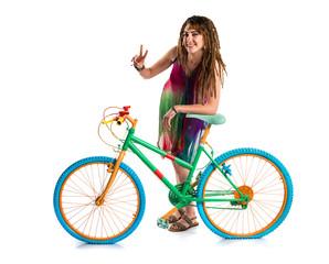 Girl with dreadlocks on colorful bike