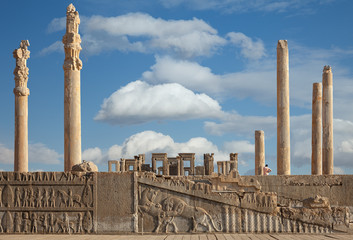 Ruins of Persepolis UNESCO World Heritage Site Against Cloudy Blue Sky in Shiraz City of Iran