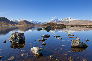 Snow covered mountains left to right are Stob a'choire Odhair, Aonach Mor, Beinn Mhic Chasgaig and Meall a'Bhuirudh, around Lochan na h-Achlaise, Lower Rannoch Moor, Argyll and Bute, Highlands, Scotland, United Kingdom, Europe