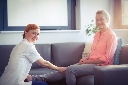 Nurse giving leg massage to woman