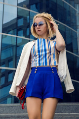 young business woman in short blue trunks