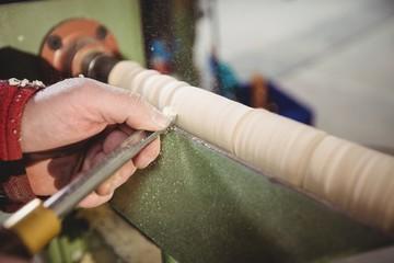 Carpenter sculpting a wood piece