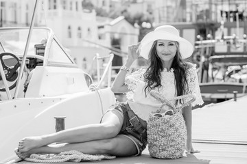 Happy beautiful young girl barefoot on a mooring