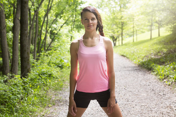 sporty woman running outdoors in park
