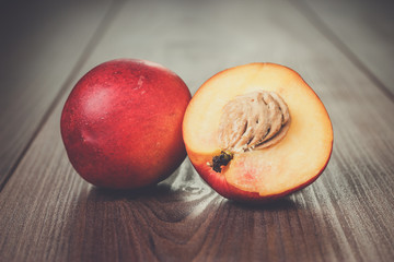 some fresh nectarines over brown wooden background