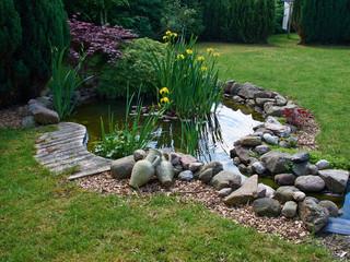 Beautiful classical garden fish pond gardening background Wall mural