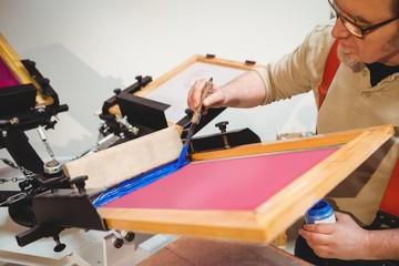 Craftsman painting on wood