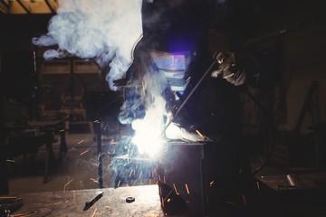 Welder cutting metal