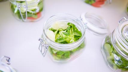 vegetable salad in glass jar on white background