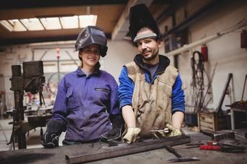 Portrait of confident metalworkers