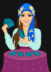 Young fortune teller forecasting future with tarot cards