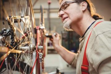 Bike mechanic repairing a bike
