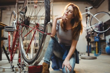 Woman looking at a bicycle
