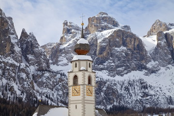 The church and village of Colfosco in Badia, 1645m, and Sella Massif range of mountains under winter snow, Dolomites, South Tirol, Trentino-Alto Adige, Italy, Europe