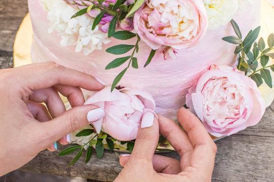 Process of decorations of big pink wedding cake