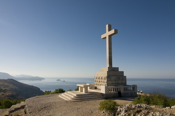 Huge Christian cross on top of the mountain above the old town of Dubrovnik, Croatia, Europe