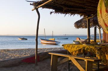 Beach cottage and fishing boats near Diego Suarez (Antsiranana), Madagascar, Indian Ocean, Africa