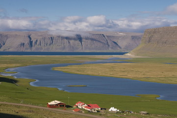 Farm in the typical landscape in fjord, Patreksfjordur, Iceland, Polar Regions
