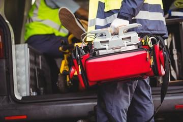 Ambulance man holding a defibrillator