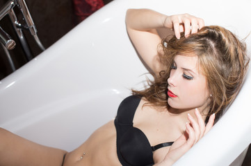 Picture of sexy beautiful young woman having fun relaxing in bath tub