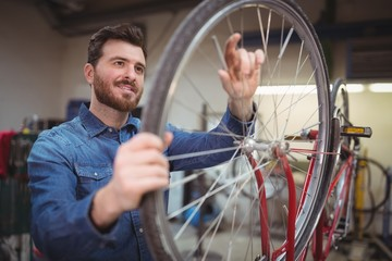 Mechanic repairing a bicycle wheel