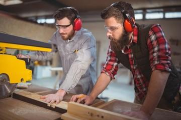 Carpenter using saw cutting machine
