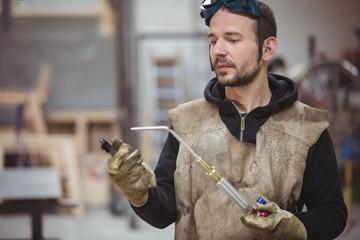 Welder holding a welding torch