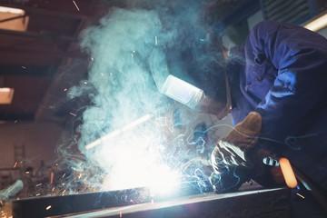 Welder working with machine