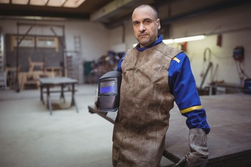 Welder looking at the camera