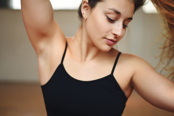 Close up of an athlete young woman at gym.