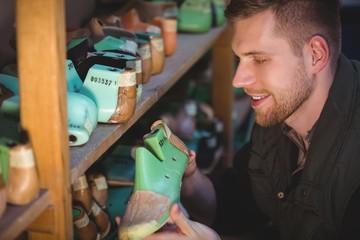 Cobbler holding a shoemaker
