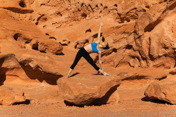 Yoga outdoor on rock in desert