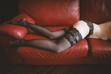 Sexy woman legs in stockings. Vintage toned.