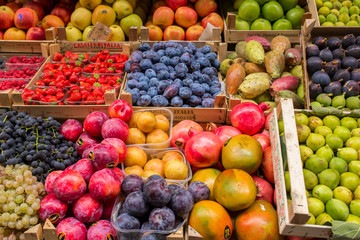 Florence, Italy - September 17, 2015: Fruits and vegetables in boxes for sale in Italian market