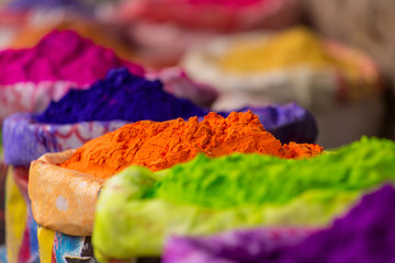 Deurstickers India Colorful piles of powdered dyes used for Holi festival in India