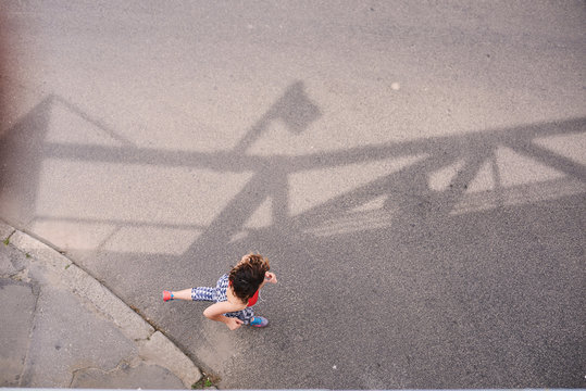 Healthy young woman running outdoors in the city. Aerial view.
