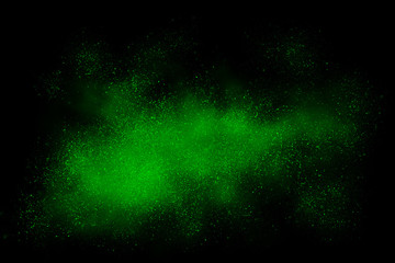 Green abstract powder explosion on a black background