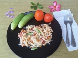 Vegetables salad  on plate, cucumbers and tomatoes