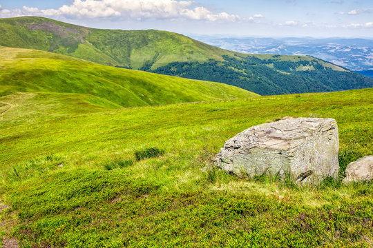 huge stone in valley on top of  the hill